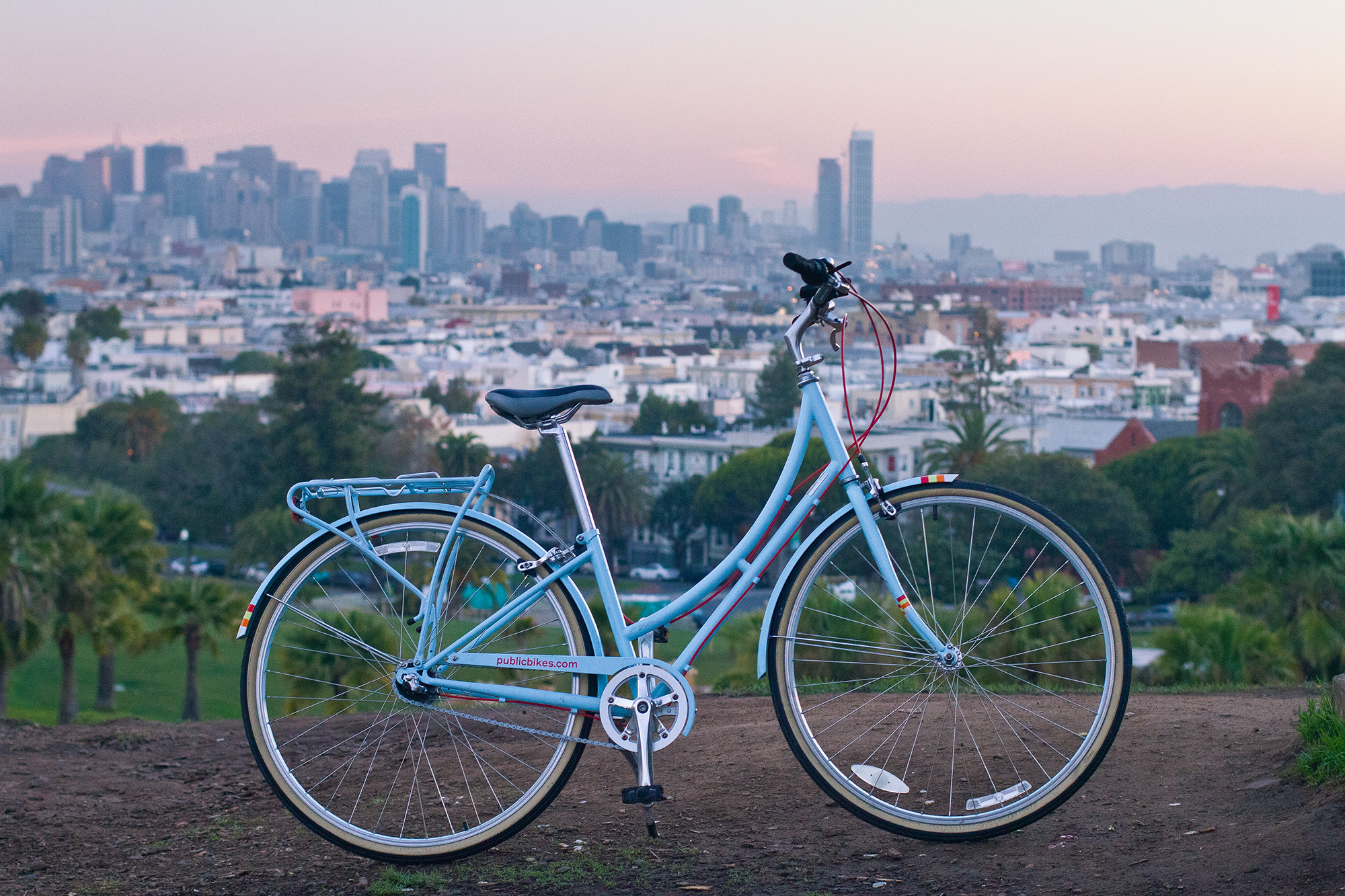 sunrise at dolores park and public bikes
